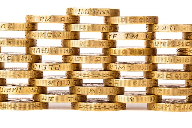 Pound coins stacked into a lattice wall