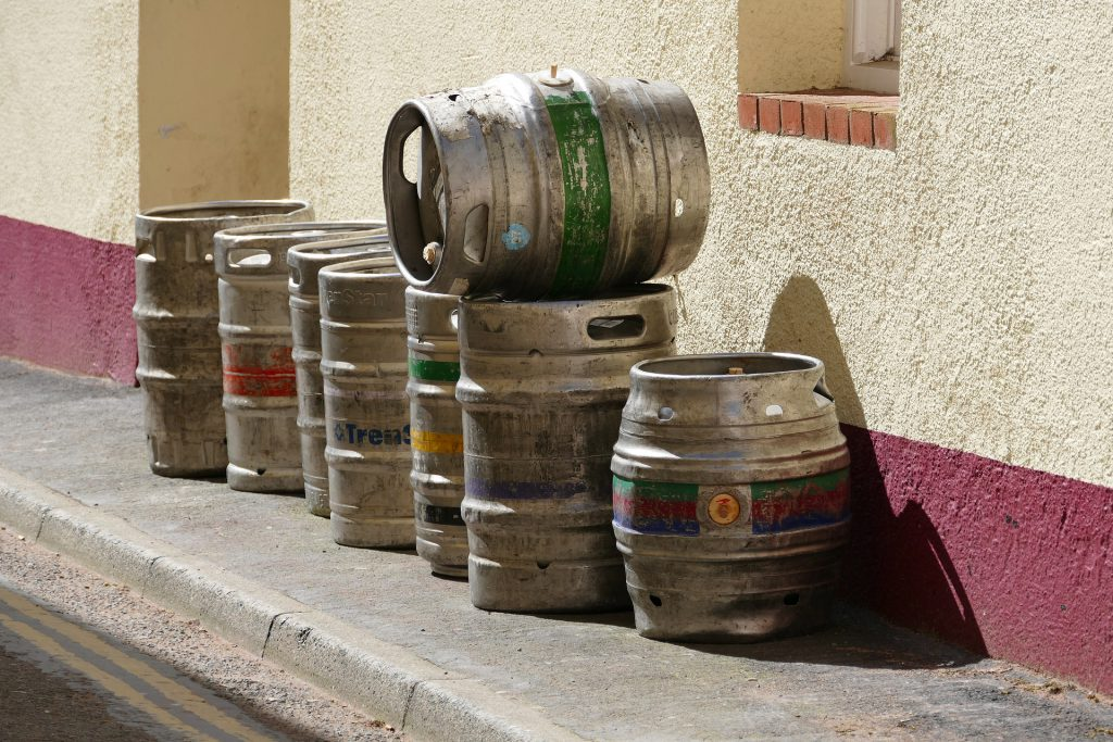 Empty beer kegs stacked outside