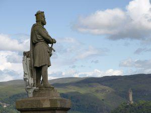 statue over looking hills