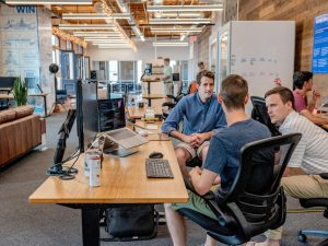 men at office desk