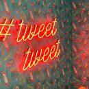 tweet hashtag in neon light form