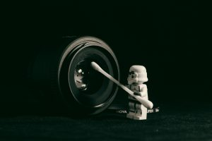 lego stormtrooper in front of a camera lens