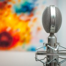 grey microphone with colourful background