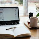 laptop, book and mug